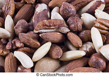 Background filled with different kinds of nuts.