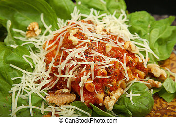 Gorgonzola, Italian blue cheese, with walnuts and basil rolled in lasagna noodles on a bed of spinach.