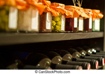 nWine bottles in a rack - Wine bottles and mason jars in a...