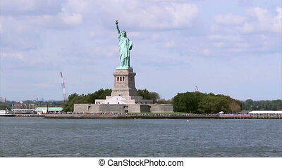 The Statue of Liberty, a colossal neoclassical sculpture on Liberty Island in middle New York Harbor, Manhattan. The statue is a robed female figure representing Libertas, the Roman goddess of freedom