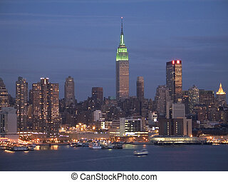 NY Skyline at Night - This is a colorful shot of the NY ...