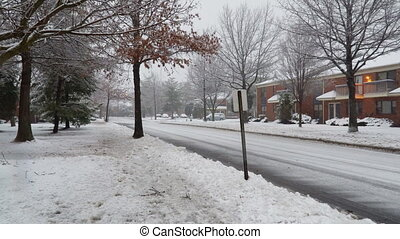 NY USA January 13, 2019: Cars covered in snowy road at city street during heavy snowfall in winter