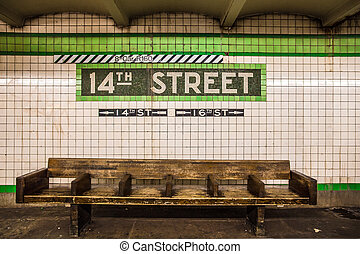 NYC Subway - Bench at New York City subway station with...