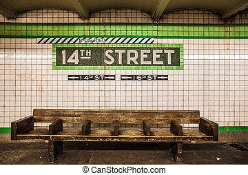 NYC Subway - Bench at New York City subway station with...