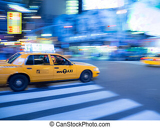NYC Taxi blur - A panning shot of a NYC taxi cab speeding...