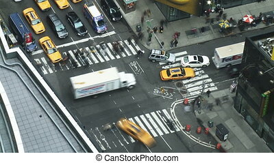 Fast motion view looking down on Times Square in Manhattan with both vehicle and pedestrian traffic filling the streets.