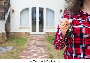 nyckel, kvinna, keychain, holdingen, hus, house., form, bakgrund, nytt hem