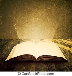 nyitott könyv, képben látható, asztal.
