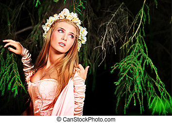 nymph - Portrait of a dreamy fairy girl in a forest.