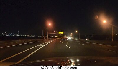 Traffic on NZ State Highway 1 in Auckland at night on Jan 18 2014.It 's the longest and most significant road in New Zealand road network, running the length of both main islands