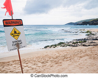 Oahu Hawaii - Warning no swimming sign, Sandy beach
