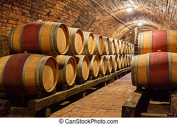 Oak barrels in a underground wine cellar