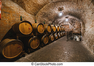 Oak barrels in an old wine cellar.