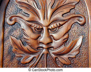 oak face - an oak carving in a piece of furniture