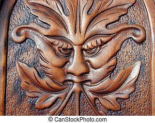 oak face - an oak carving in a piece of furniture