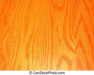 The grain of a polished piece of oak wood.