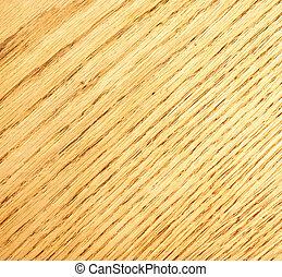 A macro shot of an oak wood board.