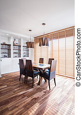 Oak wood dining table in exclusive interior