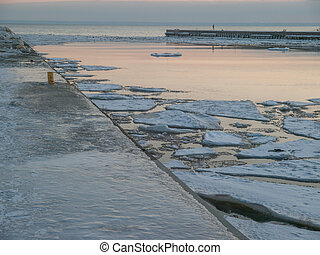 Oakville Harbour - Ice covered pier and Lake Ontario at...