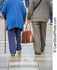 oap couple mitt bag - an elderly couple carrying a bag...
