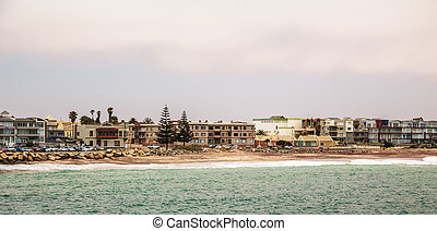 ?oastline panorama with houses in background, Swakopmund German colonial town, Namibia