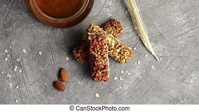 Oat bars and jar of honey - Top view of composed cereal bars...
