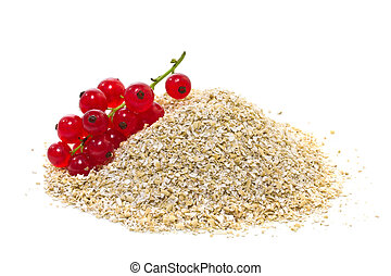 oat bran with red currants on a white background