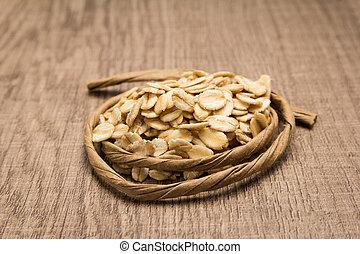 Oat cereal grain. Paper rope around grain. Selective focus.