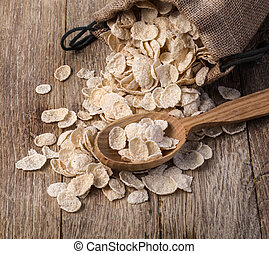 Oat cereal in burlap sack