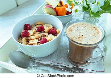 Oat cereals with fruits and cup of coffee for breakfast