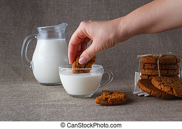 Oat cookies dunked in milk