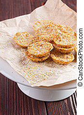 Oat cookies served on wooden table close up