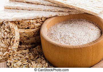 Various dietary oat products on wooden table