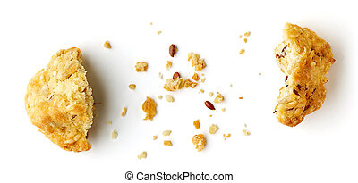 Broken oat flake cookie with seeds isolated on white background, top view