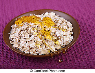 Oat flake heap isolated on violet background