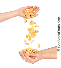 oat flakes fall out of women's hands in other hands isolated on white background