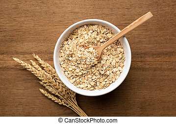 Oat flakes, grains, rolled oats in bowl