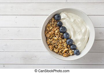 Oat flakes, granules and nuts muesli with blueberries. The concept of healthy food, Breakfast.