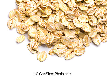 Oat flakes heap isolated on white background