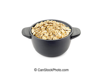 Oat Flakes in a Black Cup