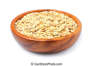 Oat flakes in a wooden bowl isolated.