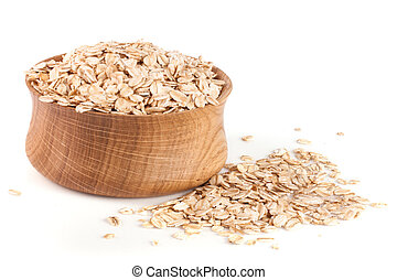 oat flakes in a wooden bowl isolated on white background