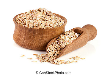 Oat flakes in a wooden bowl with a scoop isolated on white background