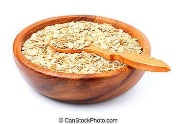 Oat flakes in a wooden bowl with spoon.