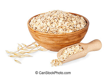 oat flakes in bowl and oat ears