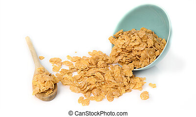 Oat flakes in bowl and wooden spoon on white background.