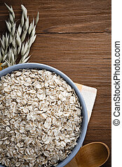 oat flakes in bowl on wood