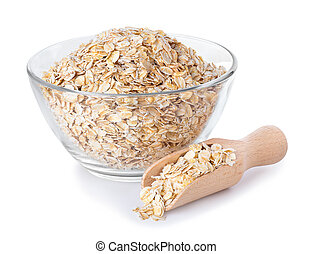 Oat flakes in glass bowl and wooden spoon isolated on white