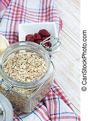 Oat flakes in glass jar on wooden table