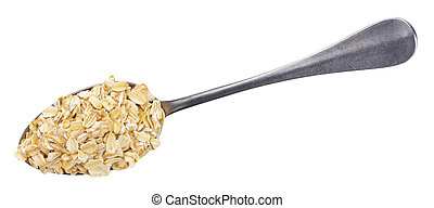 Oat flakes in spoon isolated on white background. Top view